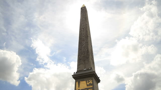 Clouds passing over obelisk
