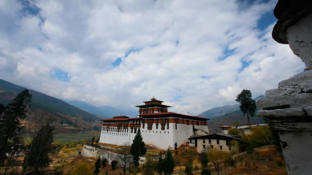 T/L, WS, clouds passing over the Paro Dzong / Paro, Bhutan