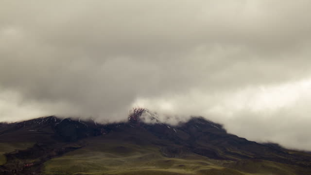 clouds passing over the summit of cotopaxi volcano, ecuador - paramo stock videos and b-roll footage