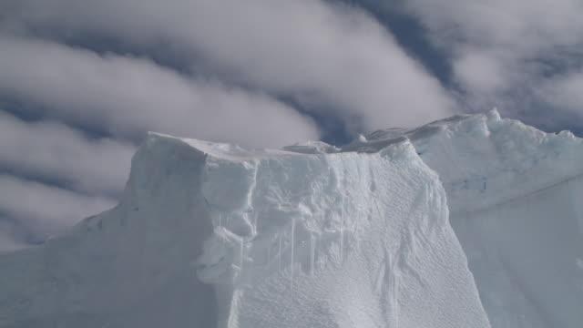 clouds past ice peak, cape washington, antarctica - cape washington stock videos & royalty-free footage