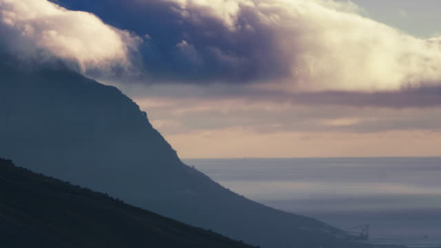 clouds pouring over table top mountains - ripido video stock e b–roll