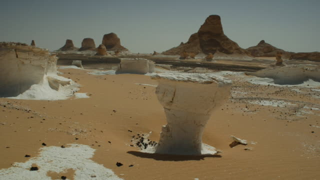 Clouds race above strange rock formations in White Desert Egypt Available in HD.