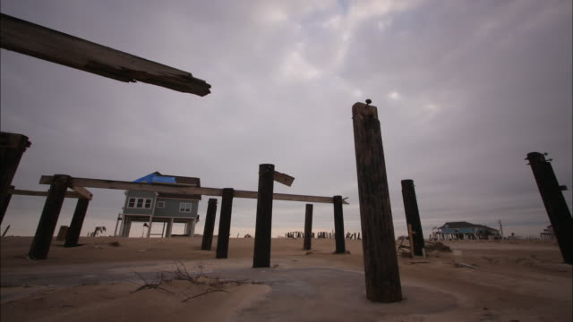 clouds race above the remains of a stilt house in the aftermath of hurricane ike. - stilt house stock videos & royalty-free footage