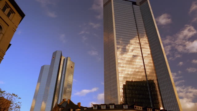 clouds reflect in downtown frankfurt's shiny skyscrapers. - deutsche bank stock videos & royalty-free footage