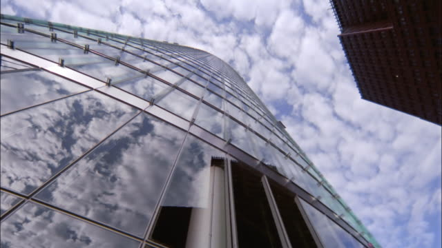 clouds reflect in the windows the skyscrapers of potsdamer platz. - potsdamer platz stock videos & royalty-free footage