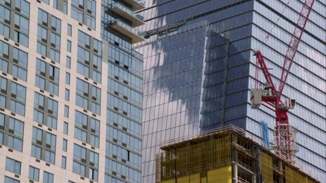Clouds reflect of New York City skyscraper.