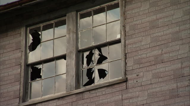 cu clouds reflecting in window of dilapidated industrial building / rutland, vermont, usa - sash window stock videos and b-roll footage