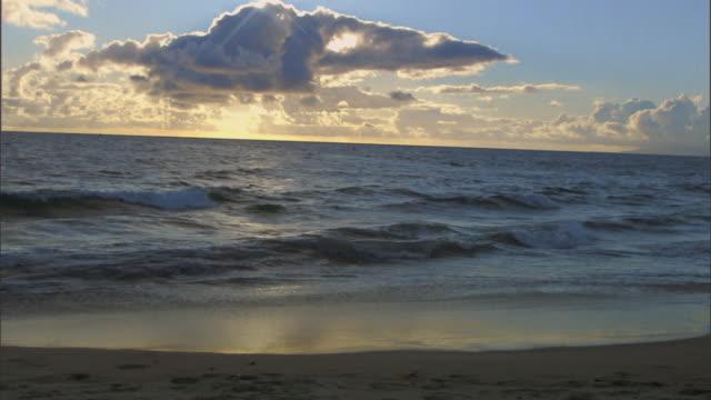 WS Clouds reflecting sunlight over sea at sunset / Vista del Mar, California, USA