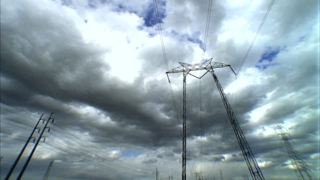 t/l ms la clouds rolling above high voltage electrical tower, san joaquin valley, california, usa - high voltage stock videos & royalty-free footage