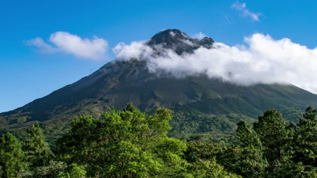 clouds rolling over arenal volcano in costa rica - costa rica stock videos & royalty-free footage