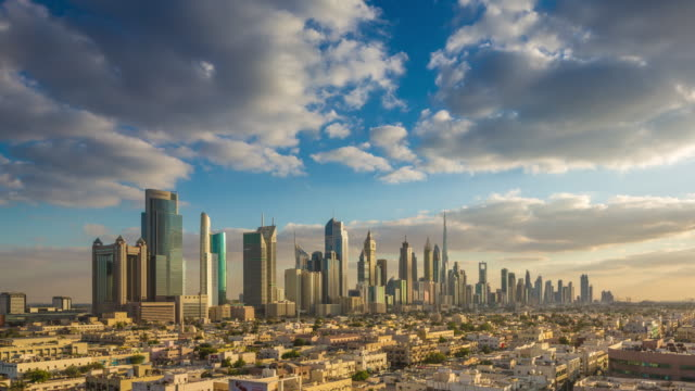 vidéos et rushes de clouds rolling over dubai downtown skyline - dubai