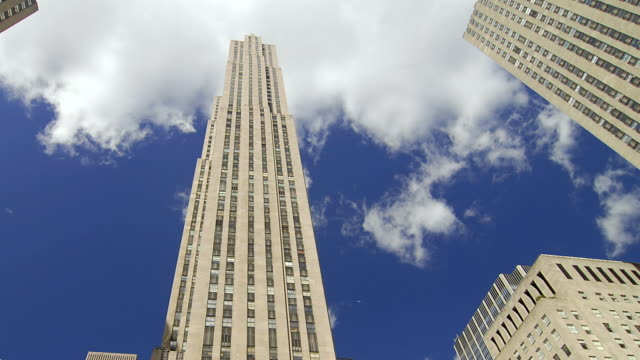 t/l clouds rolling over rockefeller center / new york city, new york, united states - rockefeller center video stock e b–roll