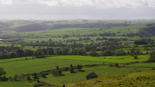 Clouds rolling over the verdant hills of the English Peak District