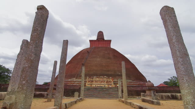 ms t/l clouds rush above jetavanaramaya stupa where part of sash tied by buddha is believed to be enshrined / anuradhapura, north central province, sri lanka - sri lankan culture stock videos & royalty-free footage