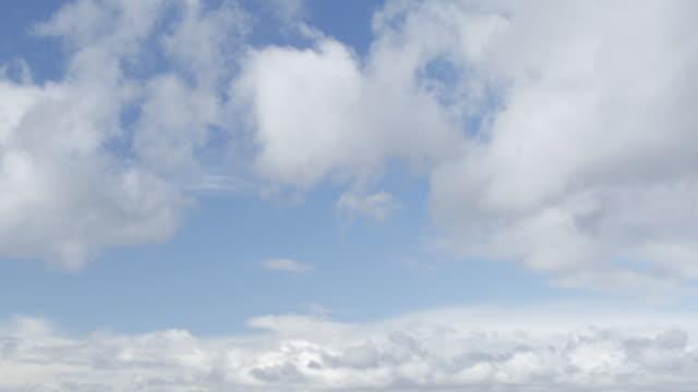 Clouds scud across sky.