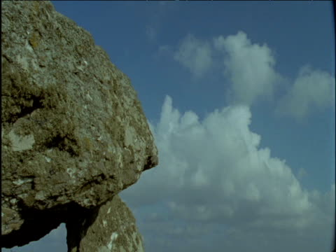clouds scud over ancient pentre ifan dolmen - obelisk stock videos & royalty-free footage