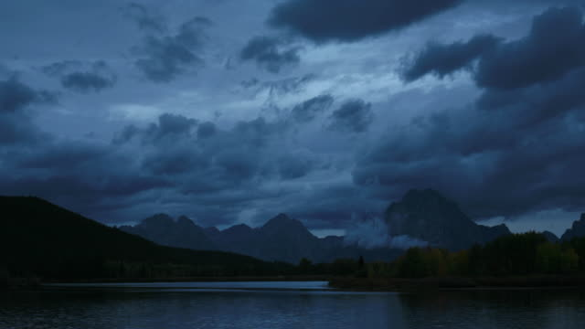 Clouds scud over Grand Teton as day breaks.