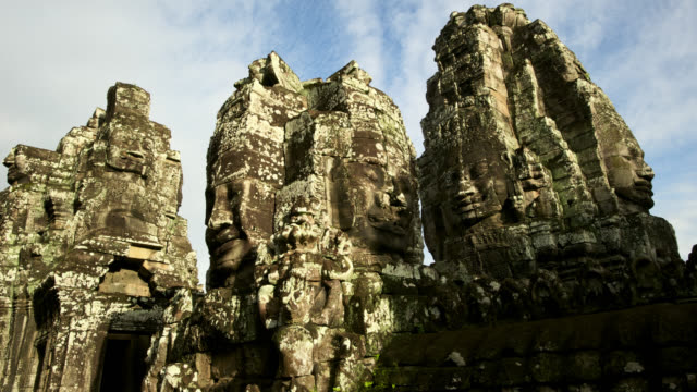 clouds scud over tower at angkor, cambodia. - carving craft product stock videos & royalty-free footage