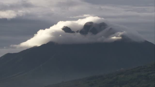 Clouds shroud the summit of a volcano in the Virunga Mountains. Available in HD.
