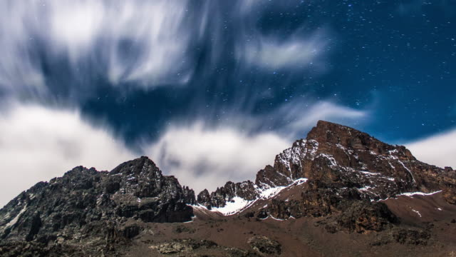 clouds & stars move over mawenzi peak mountain top - timelapse - mt kilimanjaro stock videos & royalty-free footage