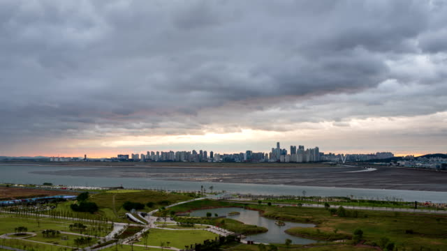 clouds sunset and night scenery of baegot life park and songdo international business district / siheung, kyonggi-do, south korea - mud flat stock videos and b-roll footage