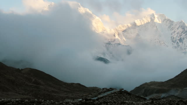 WS T/L Clouds swirl over valley in front of Ama Dablam mountain range / Pheriche, Solu Khumbu, Nepal