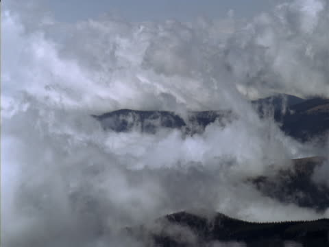 clouds swirling around foothills - foothills stock videos & royalty-free footage