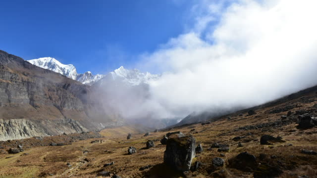 clouds time lapse mt. machapuchare from annapurna base camp ,nepal. - annapurna range stock videos and b-roll footage