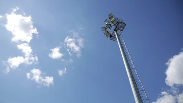 clouds timelapse over stadium light on sunny day stock video - scoring stock videos & royalty-free footage