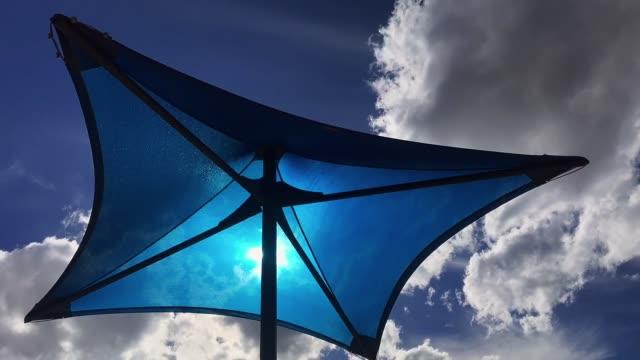 stockvideo's en b-roll-footage met wolken time-lapse met blauwe luifel - zonnescherm gefabriceerd object