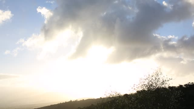 clouds wisp by hillside at sunrise - hill stock videos & royalty-free footage