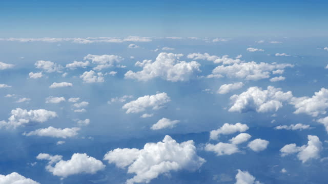 Clouds with sky from airplane window,Aerial view,Dolly shot