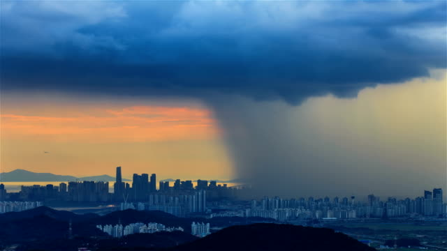 cloudscape and cityscape of incheon bridge with severe rain storm in incheon - shower stock videos & royalty-free footage