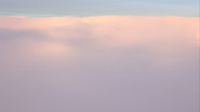 WS T/L AERIAL POV Cloudscape moving in sky at dusk
