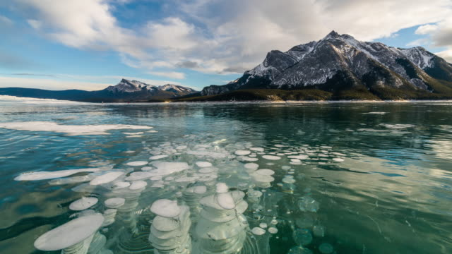 cloudscape of abraham lake in winter with air bubble - beauty in nature stock videos & royalty-free footage