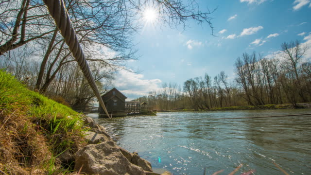 t/l 8k cloudscape over a watermill on the mur river - prekmurje stock videos & royalty-free footage