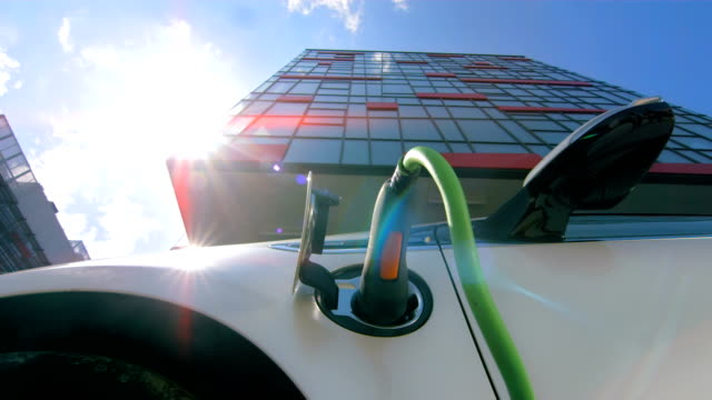 hd time lapse: cloudscape over an electric car - green stock videos & royalty-free footage