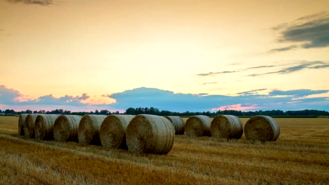 T/L Cloudscape Over Bales Of Wheat