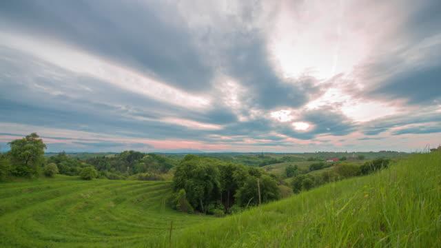 8K T/L Cloudscape over green terraced hills