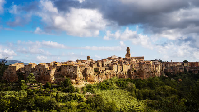t/l cloudscape over medieval town on top of plateau in italy, civita di bagnoregio - ancient stock videos & royalty-free footage