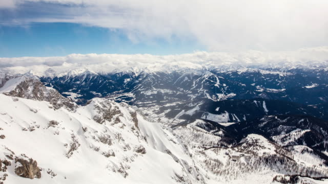 t/l cloudscape over mountain peaks in european alps - austria video stock e b–roll