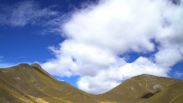 cloudscape over southern alps south island new zealand - new zealand southern alps stock videos & royalty-free footage