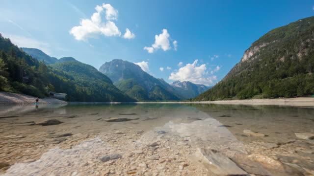 t/l cloudscape over the lake lago del predil - julian alps stock videos and b-roll footage