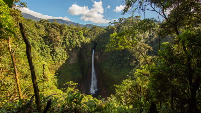 t/l 8k cloudscape over waterfall la fortuna in costa rica - costa rica video stock e b–roll