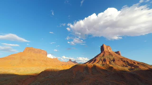 cloudscape timelapse over mesa rock tower near moab, utah - wilderness stock videos & royalty-free footage