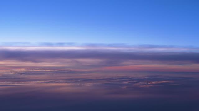 stockvideo's en b-roll-footage met cloudscape uitzicht vanuit het raam van een vliegtuig - hoog