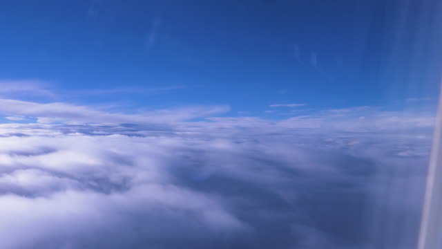 cloudscape view from an airplane window - heaven stock videos & royalty-free footage