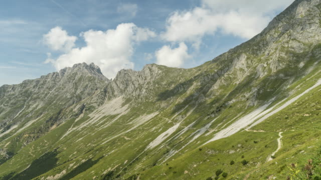 cloudscape view on trail on slope of alps of austria in summer, hafelekarspitze-seegrube at karwendel mountain,innsbruck austria - european alps stock videos & royalty-free footage