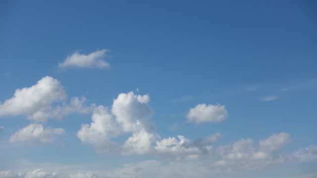 cloudscape with lots of blue sky time lapse - rolling stock videos & royalty-free footage