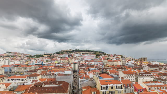 Cloudy aerial timelapse of Saint George Castle and Lisbon cityscape (Baixa district). Portugal. April, 2017